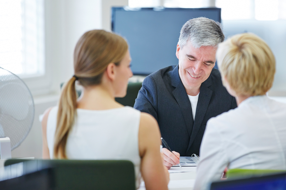image of two women and a man in a financial meeting